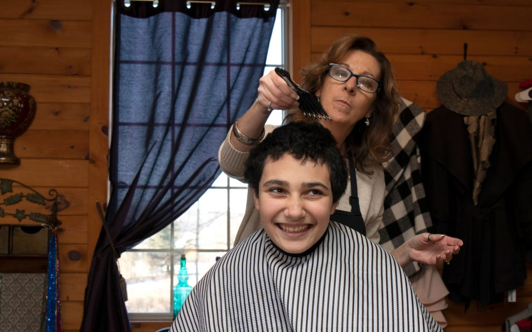 06. After years of avoiding the barber's chair, it appears that John might actually enjoy some parts of getting his hair cut. John smiled and voiced his approval as Donna combed his hair.
