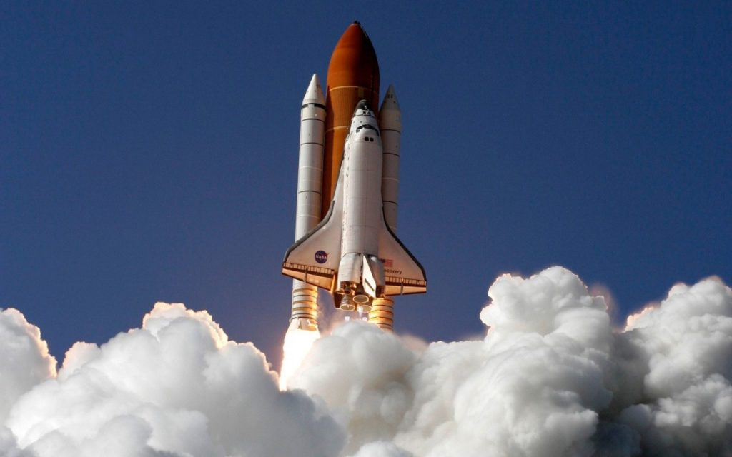 NASA shuttle ascends into space
